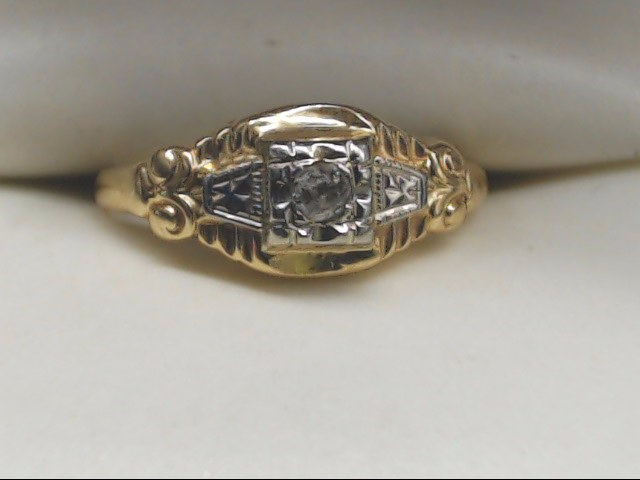 Lady's Diamond Solitaire Ring .10 CT. 14K Yellow Gold 1.1g Size:5