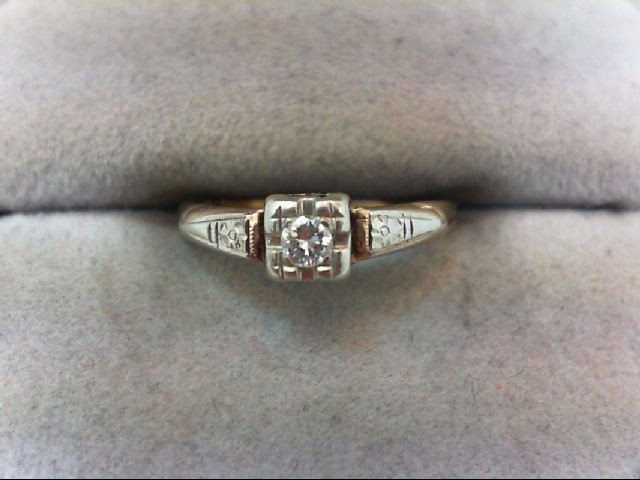 Lady's Diamond Solitaire Ring .12 CT. 14K Yellow Gold 1.4g