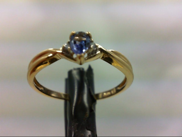 Tanzanite Lady's Stone & Diamond Ring 2 Diamonds .02 Carat T.W. 10K Yellow Gold