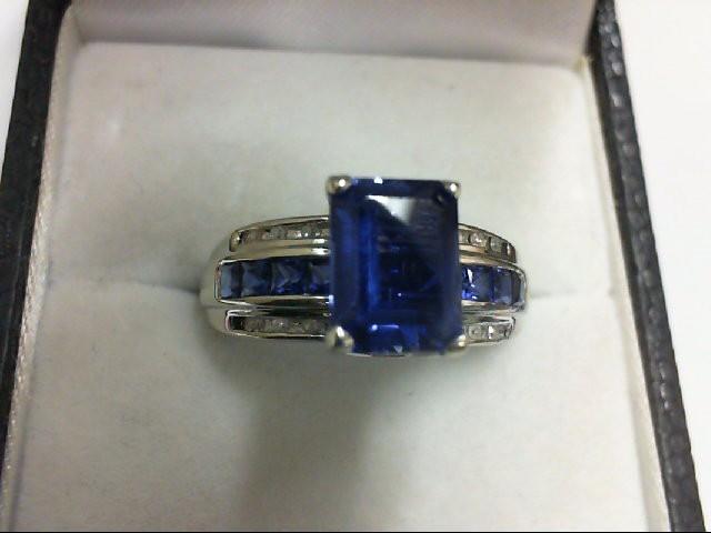 Synthetic Blue Stone Lady's Stone & Diamond Ring 12 Diamonds 0.12 Carat T.W. 10K