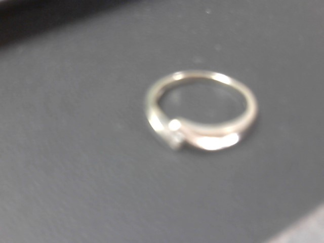 Lady's Diamond Solitaire Ring .07 CT. 14K White Gold 2.2g Size:6