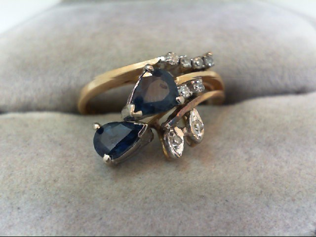 Sapphire Lady's Stone & Diamond Ring 8 Diamonds .14 Carat T.W. 14K Yellow Gold