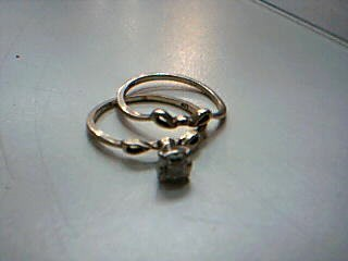 Lady's Diamond Engagement Ring .01 CT. 10K Yellow Gold 2.1g