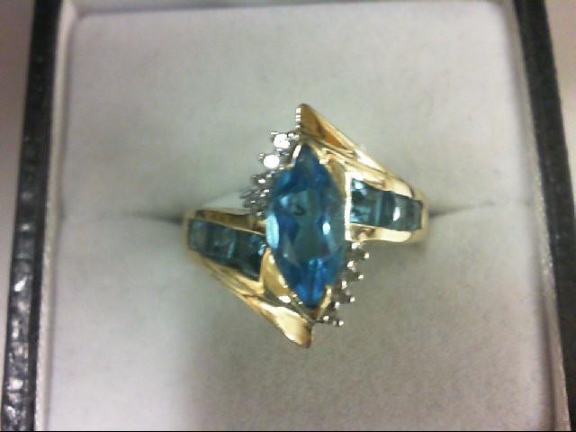 Blue Topaz Lady's Stone & Diamond Ring 8 Diamonds 0.08 Carat T.W. 14K Yellow Gol