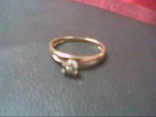 Lady's Diamond Fashion Ring 7 Diamonds .09 Carat T.W. 10K Yellow Gold 1.4g