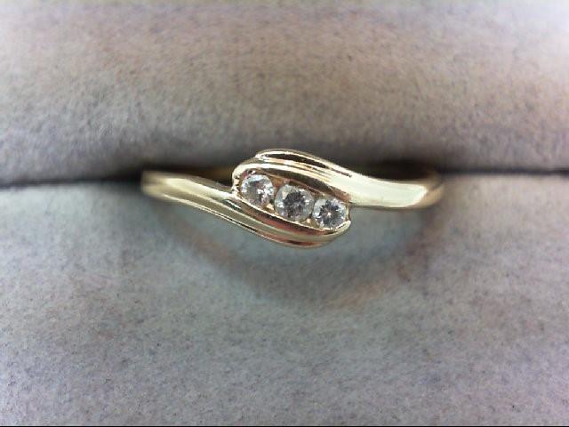 Lady's Diamond Fashion Ring 3 Diamonds .10 Carat T.W. 14K Yellow Gold 1.3g