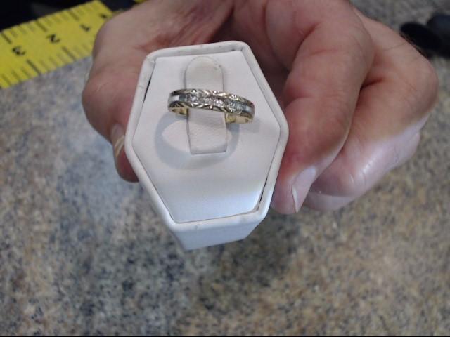 Lady's Diamond Wedding Band 5 Diamonds .05 Carat T.W. 10K Yellow Gold 1.25dwt
