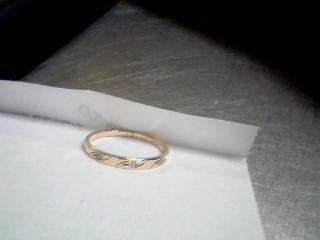 Lady's Diamond Wedding Band 3 Diamonds .03 Carat T.W. 10K Yellow Gold 1.16g