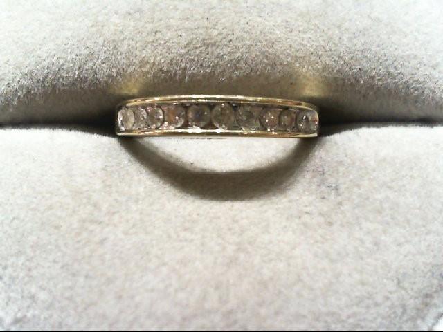 Lady's Diamond Wedding Band 10 Diamonds .20 Carat T.W. 10K Yellow Gold 1.6g