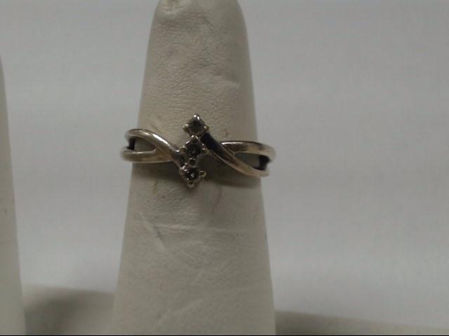 Lady's Diamond Fashion Ring 3 Diamonds .03 Carat T.W. 14K White Gold 2.32g