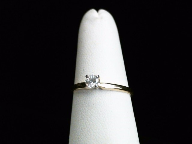 Lady's Diamond Solitaire Ring .15 CT. 14K Yellow Gold 1.6g Size:6.5