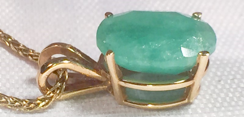 OVAL CUT NATURAL EMERALD SET IN 14K YELLOW GOLD