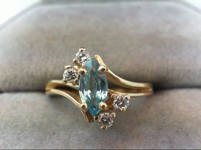 Blue Topaz Lady's Stone Ring 4 Diamonds .12 Carat T.W. 14K Yellow Gold 3.1g