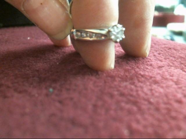 Lady's Diamond Solitaire Ring 11 Diamonds .22 Carat T.W. 10K White Gold 1.7dwt