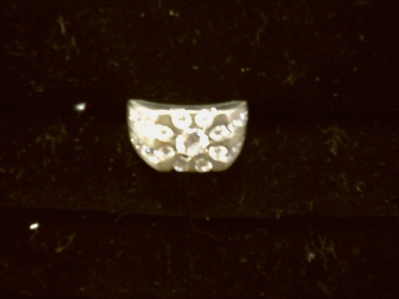 LARGE CZ W/ MUTLIPLE CZ AROUND CENTER STONE AND TWO ROWS DOWN EITHER SIDE SIZE11