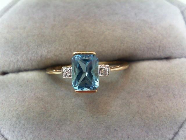 Blue Topaz Lady's Stone & Diamond Ring 2 Diamonds .02 Carat T.W.