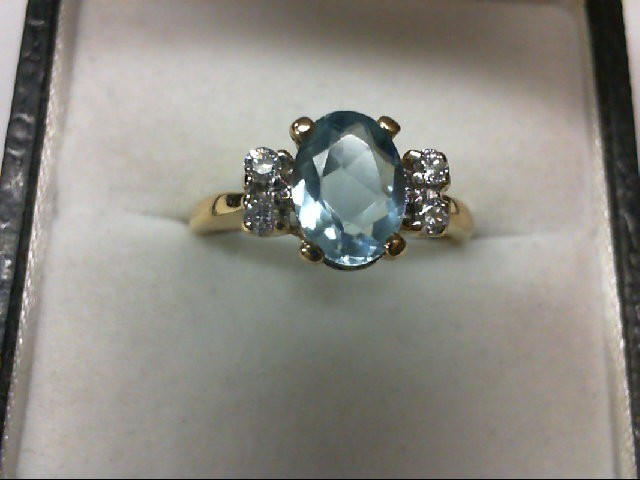 Aquamarine Lady's Stone & Diamond Ring 4 Diamonds 0.12 Carat T.W. 14K Yellow Gol