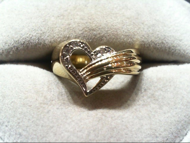 Lady's Diamond Fashion Ring 4 Diamonds .04 Carat T.W. 14K 2 Tone Gold 5.1g