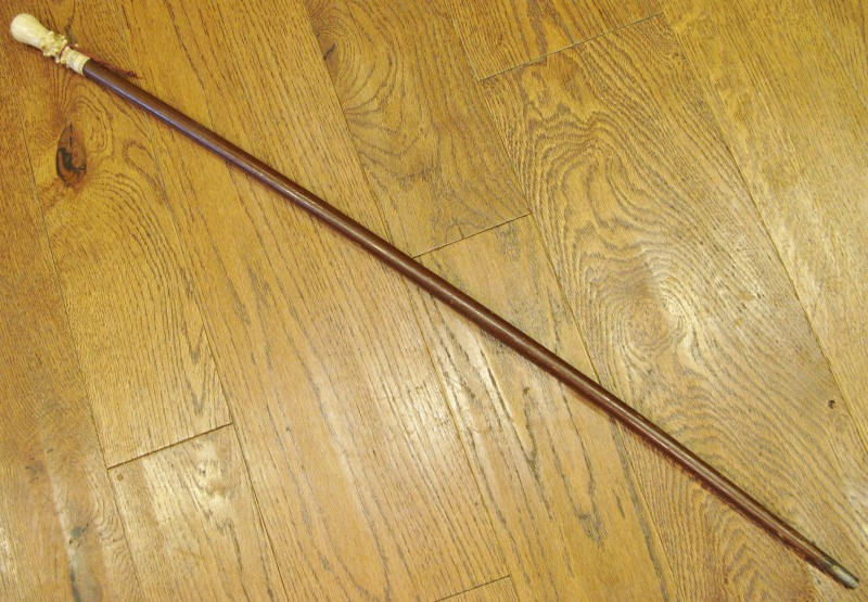 ANTIQUE WOOD WALKING CANE WITH IVORY HANDLE AND TIN/METAL TIP.  THIS CANE IS F
