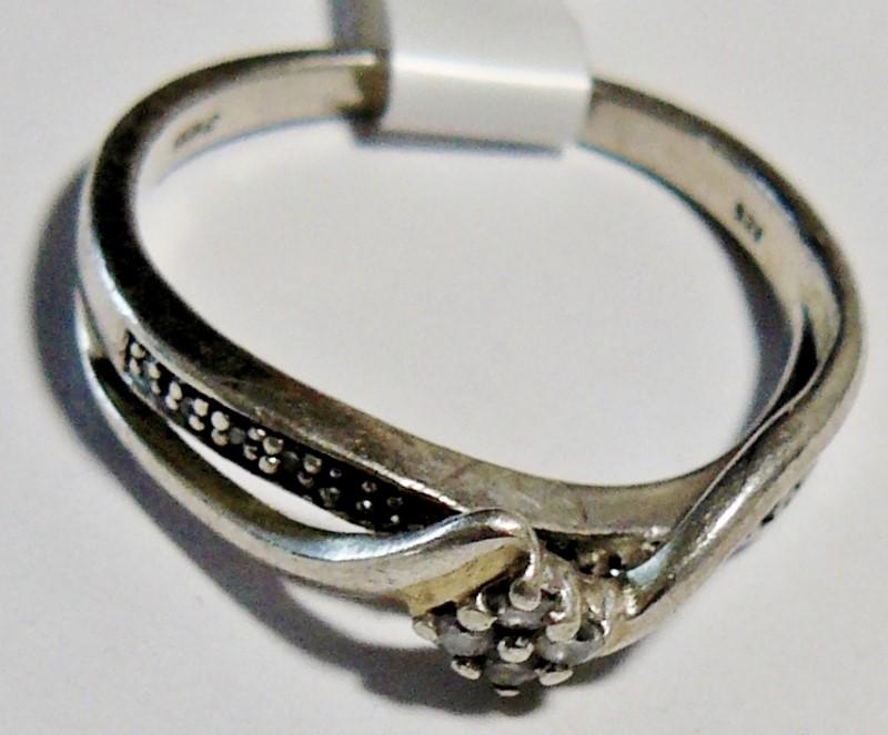 Lady's Silver-Diamond Ring 4 Diamonds .04 Carat T.W. 925 Silver 1.6dwt Size:7