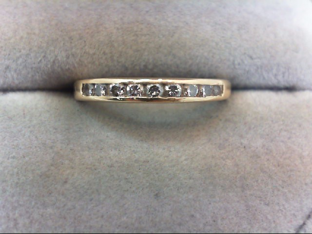 Lady's Diamond Wedding Band 9 Diamonds .18 Carat T.W. 14K Yellow Gold 1.7g
