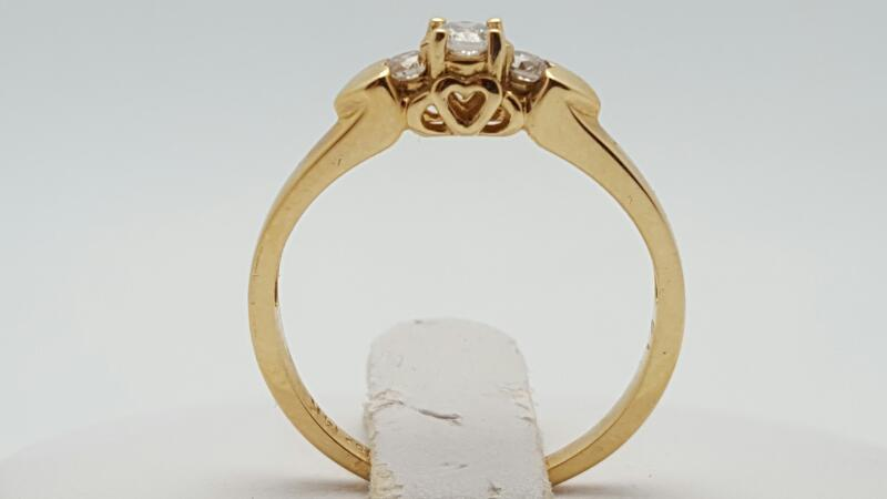 Lady's Diamond Fashion Ring 3 Diamonds .21 Carat T.W. 14K Yellow Gold 2.3g