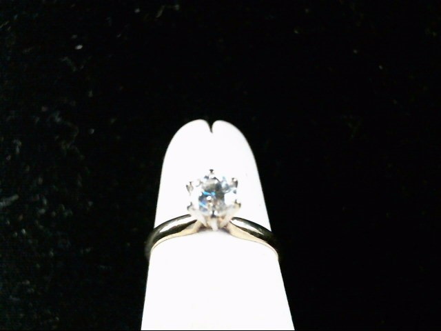 Lady's Diamond Solitaire Ring .56 CT. 14K Yellow Gold 1.5g Size:4.5