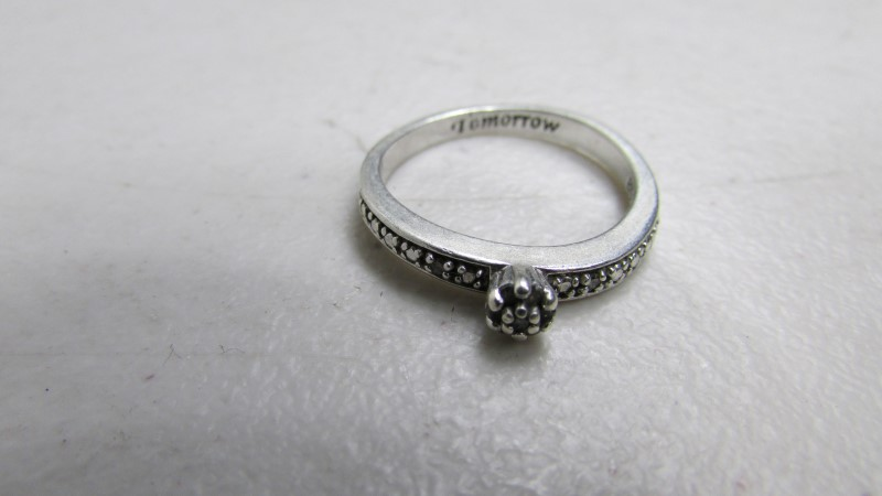 Lady's Silver-Diamond Ring 9 Diamonds .09 Carat T.W. 925 Silver 2.93g Size:9