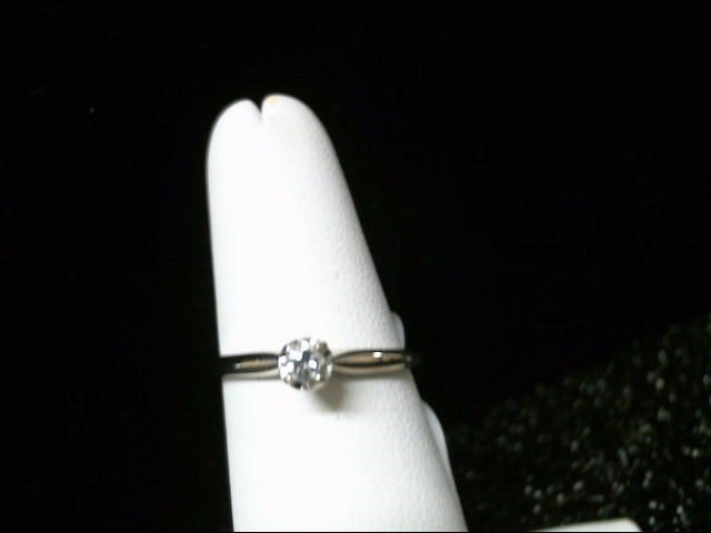 Lady's Diamond Solitaire Ring .08 CT. 14K White Gold 1.8g Size:7