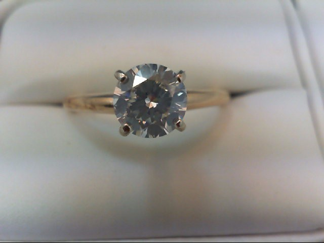 Lady's Diamond Solitaire Ring .87 CT. 14K Yellow Gold 2.14g