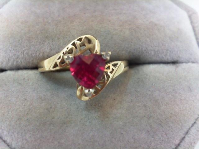 Lady's Diamond Fashion Ring 3 Diamonds .03 Carat T.W. 10K Yellow Gold 2.3g