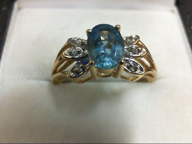 Blue Topaz Lady's Stone & Diamond Ring 2 Diamonds 0.02 Carat T.W. 14K Yellow Gol