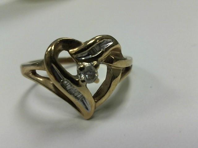 Lady's Diamond Fashion Ring 5 Diamonds .07 Carat T.W. 10K Yellow Gold 2dwt