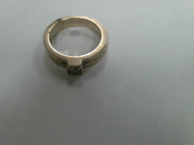 Lady's Diamond Solitaire Ring .05 CT. 14K Yellow Gold 3.4dwt