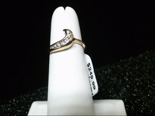 Lady's Diamond Fashion Ring 7 Diamonds .14 Carat T.W. 14K Yellow Gold 2.3g