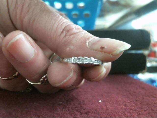 Lady's Diamond Fashion Ring 9 Diamonds .13 Carat T.W. 14K White Gold 1.4dwt