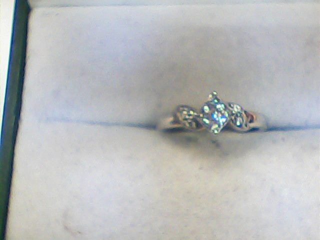 Lady's Diamond Fashion Ring 13 Diamonds .22 Carat T.W. 14K White Gold 1.1dwt