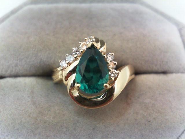 Emerald Lady's Stone & Diamond Ring 8 Diamonds .24 Carat T.W. 14K Yellow Gold