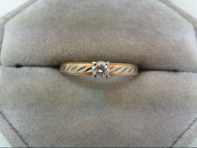 Lady's Diamond Solitaire Ring 0.15 CT. 14K Yellow Gold 2.3g