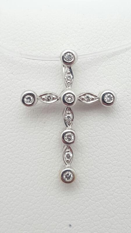14kw Gold Diamond Cross Pendant 11 Diamonds .11 Carat T.W. 1.1g