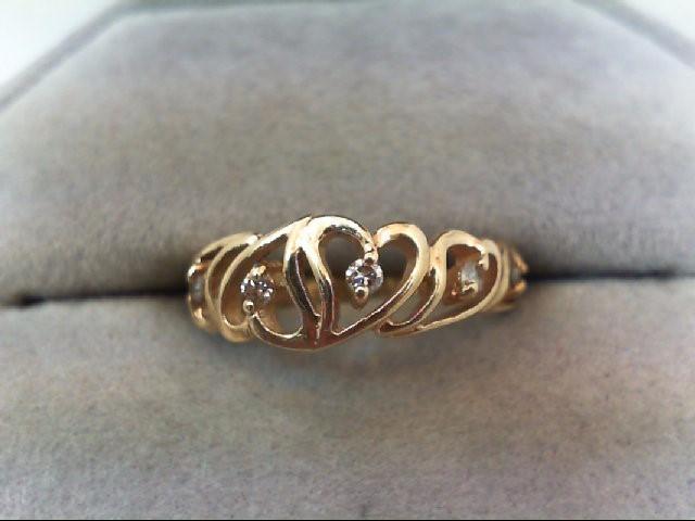 Lady's Diamond Fashion Ring 6 Diamonds .12 Carat T.W. 14K Yellow Gold 2.1g