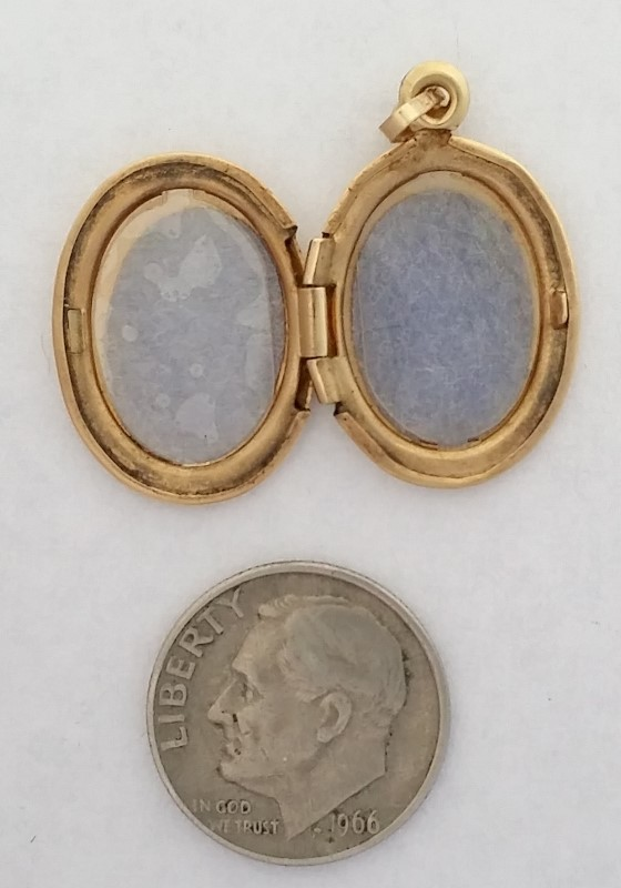 Locket with Etchings set in 14K Yellow Gold