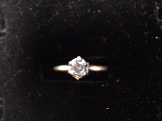 Lady's Diamond Solitaire Ring .05 CT. 14K Yellow Gold 2g Size:7