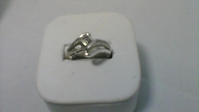 Lady's Silver-Diamond Ring 4 Diamonds .04 Carat T.W. 925 Silver 4.2g