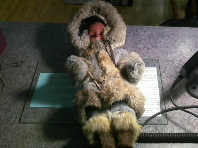 HAND MADE ESKIMO DOLL WITH REAL RABBIT FUR CLOTHES.