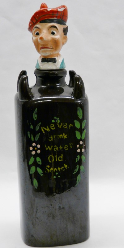 OLD SQUARE SCOTCH LIQUER BOTTLE WITH A SCOTS MAN HEAD WEARING A TAM FOR A CORK