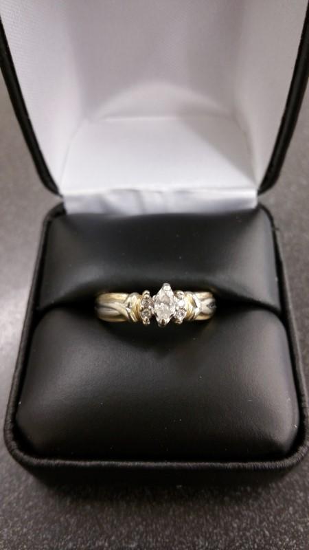 Lady's Diamond Solitaire Ring 3 Diamonds .29 Carat T.W. 14K Yellow Gold 4.3g