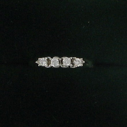 Lady's Diamond Fashion Ring 4 Diamonds .16 Carat T.W. 14K White Gold 1.4dwt