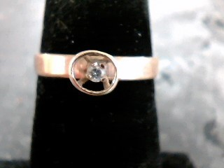 Lady's Diamond Solitaire Ring .01 CT. 10K Yellow Gold 1.3dwt