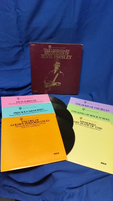 RECORD ALBUM MUSIC & MOVIES; ELVIS COLLECTABLE RECORDS IN MAROON CS